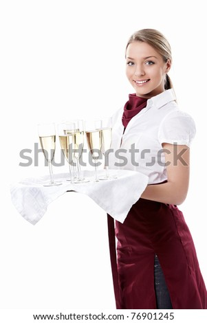 Young waitress carrying a tray with glasses of champagne on a white background