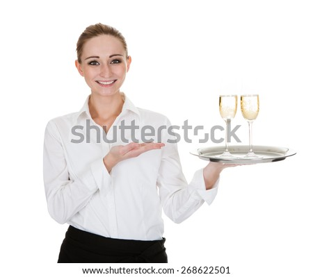 Young Waitress Carrying A Tray With Wine Glasses Over White Background - stock photo