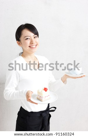 young waitress serving cake and coffee on an isolated background - stock photo