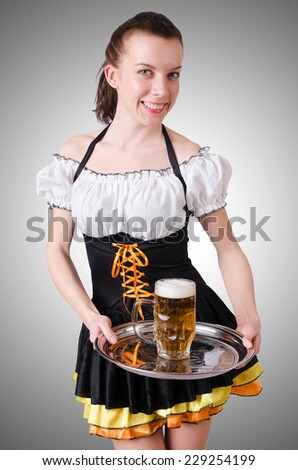 Young waitress with beer on white - stock photo