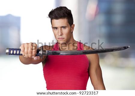 Young warrior holding a ninja sword - stock photo