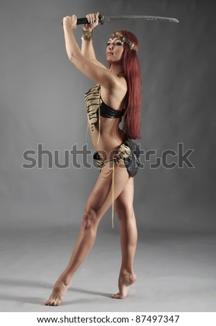 young warrior woman holding sword in her hand