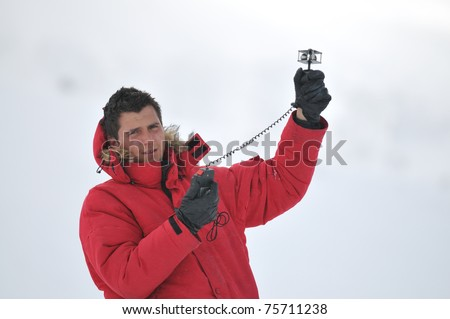 young weather meteo man measure wind speed at winter season