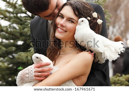 young wedding couple, beautiful bride with groom with pigeons - stock photo