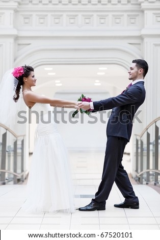 Young wedding couple. Bright white colors. - stock photo
