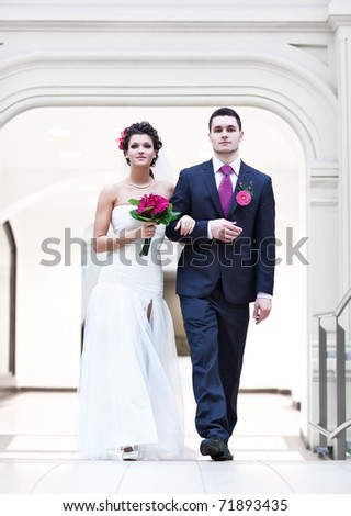 Young wedding couple. Bright white colors.