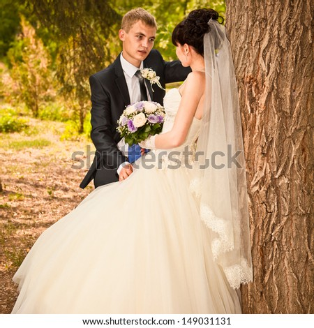 young wedding couple - freshly wed groom and bride posing