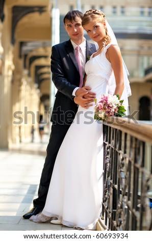 Young wedding couple indoors. - stock photo