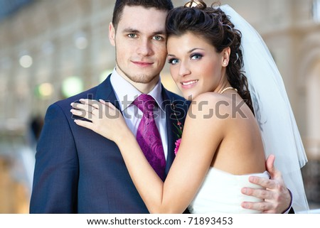 Young wedding couple indoors portrait. - stock photo