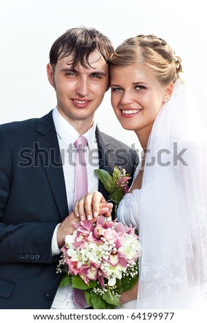 Young wedding couple outdoors portrait. - stock photo