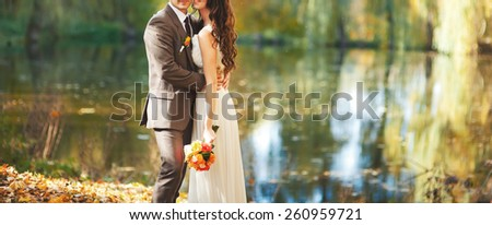 Young wedding couple together in magic forest.  - stock photo