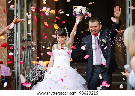 Young wedding couple. Traditional coming out after marriage registration - stock photo