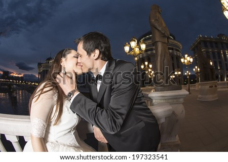 Young wedding couple , unusual artistic city light portrait