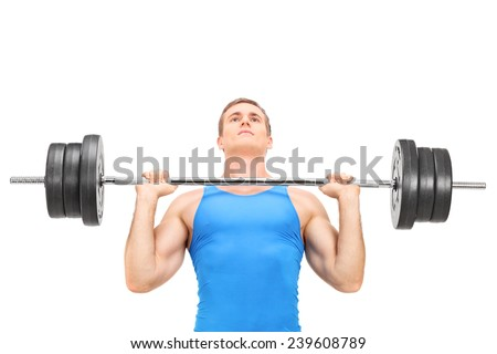 Young weightlifter training with a heavy barbell isolated on white background - stock photo