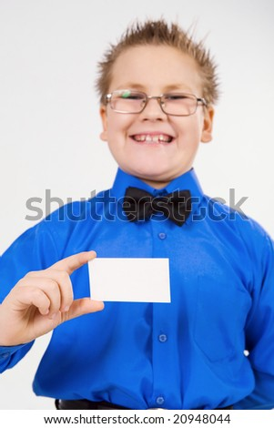 Young well-dressed boy holding an empty advertising card