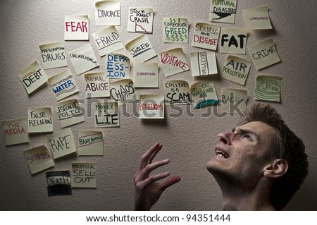 Young white Caucasian male is calls out to God asking why he would allow suffering in this world. - stock photo