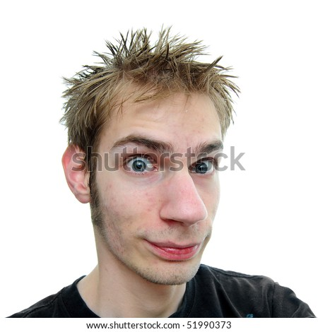 Young white Caucasian teenage adult male staring at the camera with wide eyes, spiky hair, raised eyebrows, and a little smirk - stock photo