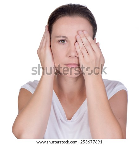 Young white deaf or hearing impaired woman holding one hand over her ear and the other hand to cover her one eye, on white background in studio - stock photo