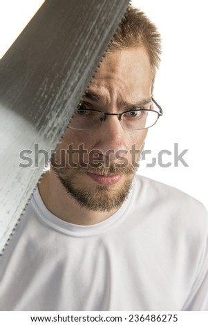 Young white male holding a saw isolated on white background - stock photo