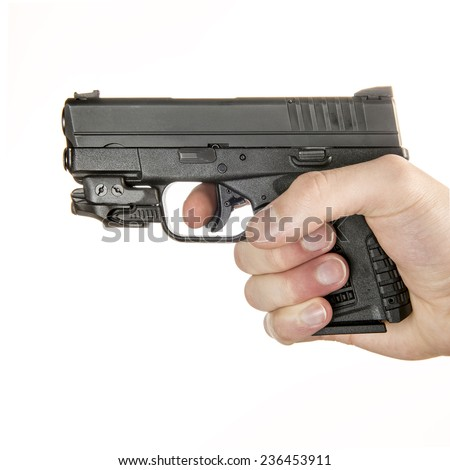 Young white male in his 20s holding a .45 ACP handgun  isolated on white background - stock photo