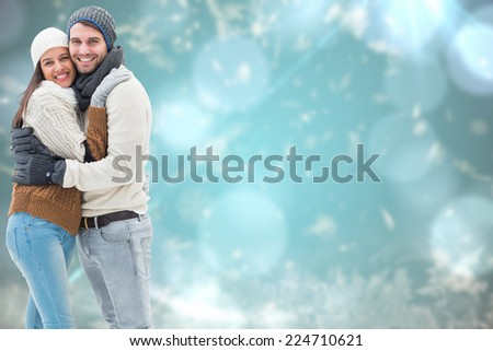 Young winter couple against blurred christmas background - stock photo