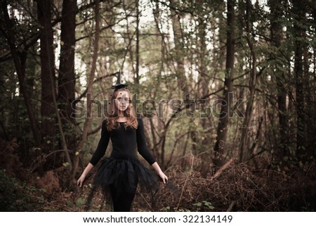 young witch in forest