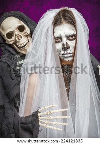 Young woman a bride in a veil day of the dead mask skull face art and skeleton. Halloween face art. - stock photo
