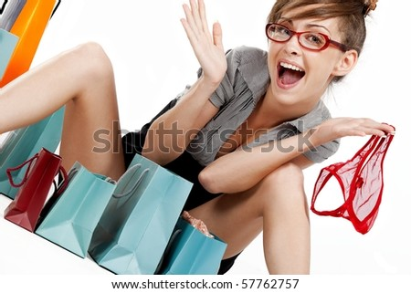 Young woman admiring her shopping - stock photo