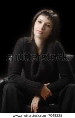 Young woman against a dark background