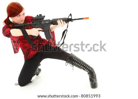 Young woman aiming Pellet Air Rifle over white background.