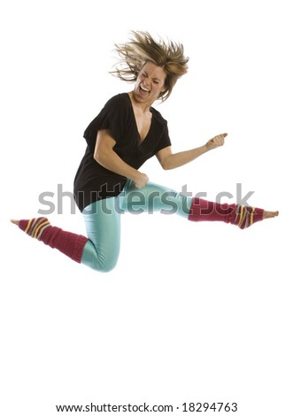 Young woman airborne playing air guitar in studio against white background. - stock photo