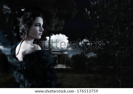 Young woman alone in the woods - stock photo