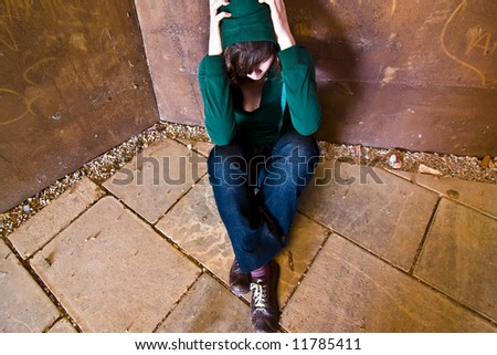 Young woman alone in urban background. - stock photo