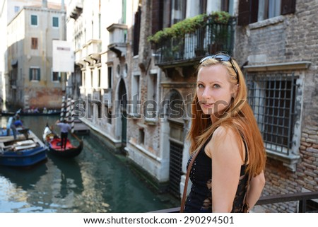 young woman amongst  historic houses and canals in Veniceyoung woman amongst  historic houses and canals in Venice - stock photo