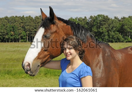 Young woman and a horse