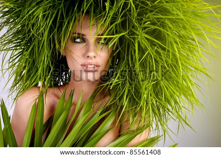 Young  woman and abstract green hair - stock photo