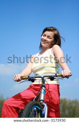 young woman and bike - break - stock photo