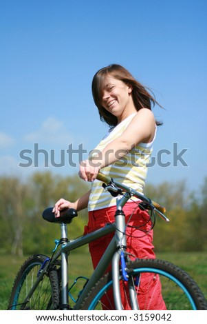 young woman and bike, relax time - stock photo