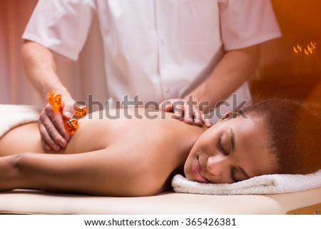 Young woman and deep relaxation on massage at spa - stock photo