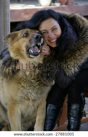 Young woman and dog play together