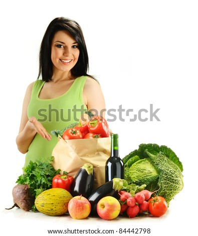 Young woman and groceries isolated on white - stock photo
