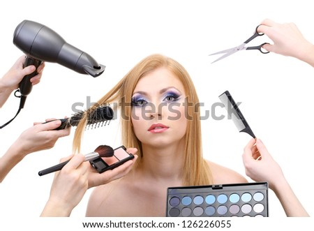 Young woman and hands with eyes shadows, brush, scissors and hairdryer, isolated on white - stock photo
