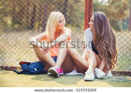 young woman and her best friend having fun together outside