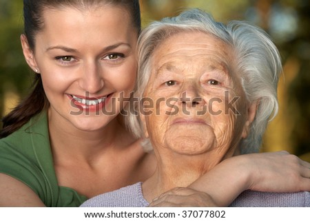 Young woman and her grandmother - stock photo