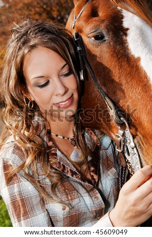 Young woman and her horse, close up of woman. - stock photo