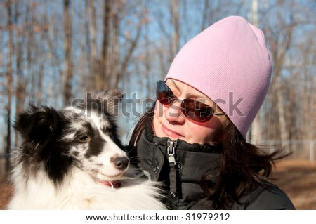 young woman and her shetland sheepdog puppy
