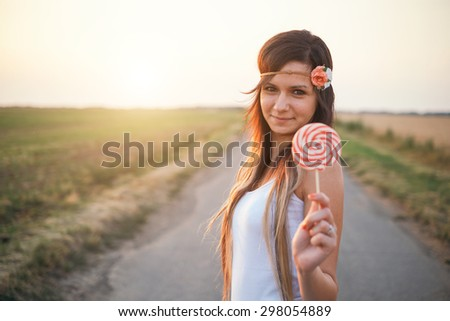 Young woman and lollipop