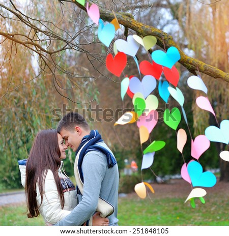 young woman and man in the decoration of the heart, on the feast of St. Valentine.