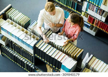 Young woman and man in the library