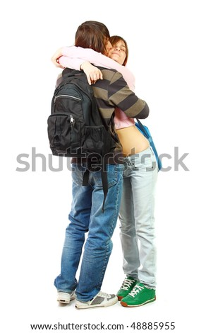 Young woman and man standing and bags, isolated on white - stock photo